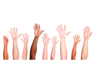 diverse group of hands reaching up
